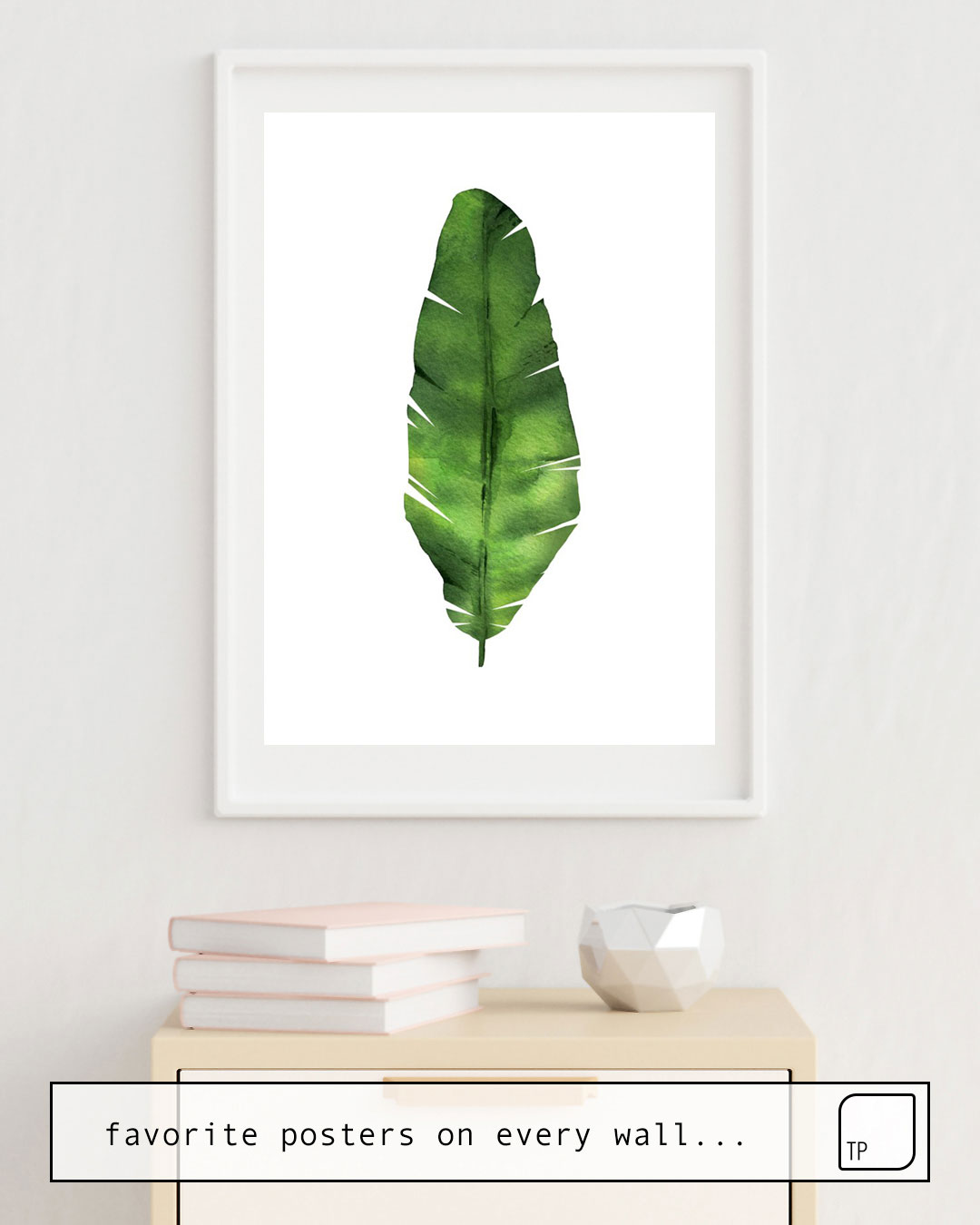 The photo shows an example of furnishing with the motif BANANA LEAF. WATERCOLOR ILLUSTRATION. by Art by ASolo as mural